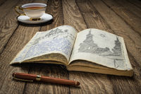 vintage expedition journal on a rustic picnic table