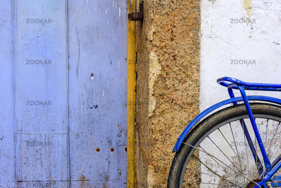 Detail of old bicycle stops in front of the historic house in the city of Paraty