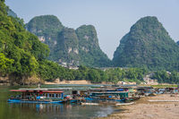 Local boats on the riverbank of Li River in Yangshuo