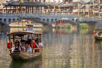 Tourists in old wooden boats in Fenghuang