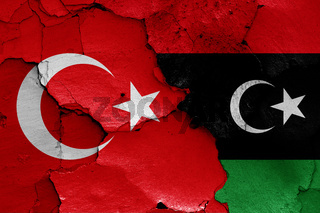 flags of Turkey and Libya painted on cracked wall