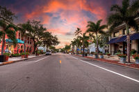 Sunrise over the Third Street shopping district in Old Naples, Florida.