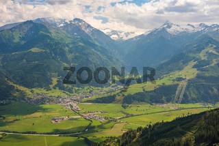 Aerial view of the town of Kaprun in Austria. City surrounded by Tirol Alps mountains. View from above.