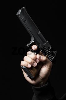 male hand with gun isolated on black background