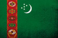 The Republic of Turkmenistan National flag. Grunge background