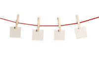 Set of blank notes held on string isolated