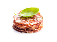 Sliced italian salami with hazelnuts and basil leaf
