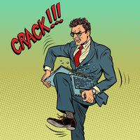 Businessman breaks laptop in rage