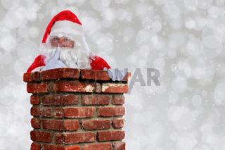 Santa Claus Going Down Chimney making Shh sign with finger to lips.