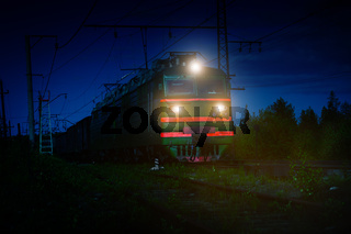 Electric Freight Train Approaching Polyarnye Zori, Russia, at Night