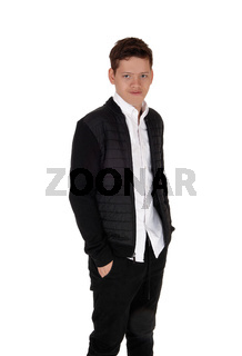 Happy teenager standing in a black jacket