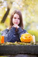 Girls with pumpkins on Halloween