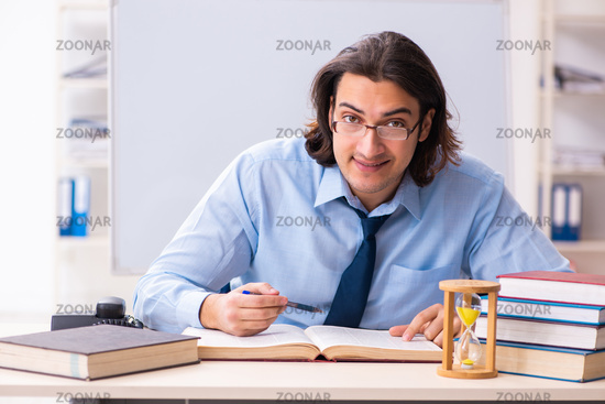 Young businessman student in time management concept