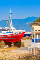 Mykonos island in Greece and old red ship