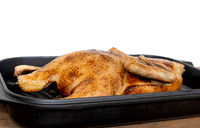 whole roasted or slowly baked duck in roasting pan
