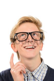 Happy boy wearing geek glasses having idea