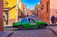 San Miguel de Allende, Mexico - February 24, 2020: Colorful street of San Miguel de Allende, colonial town in Mexico. UNESCO World Heritage Site.