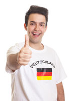 German sports fan with black hair showing thumb up