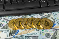 Computer and bitcoins on money - business background