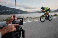 cinematographer taking action shot of triathlon bike athlete