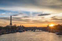 Paris France sunset city skyline at Seine River with Pont Alexandre III bridge and Eiffel Tower