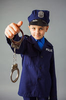 Little boy pretending to be a police officer.