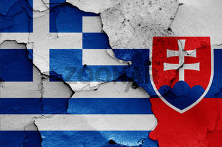 flags of Greece and Slovakia painted on cracked wall
