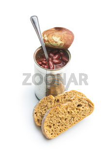 Canned red beans in tomato sauce in tin can and bread.