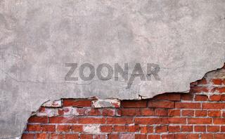 Wand mit Putz und Mauersteinen