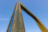 Bottom up view of The Dubai Frame on a clear sunny day