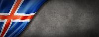 Icelandic flag on concrete wall banner