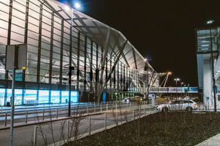 Terminal of Gdansk airport (GDN) in Poland. Exterior view of The Gdansk Lech Walesa Airport. Gdansk Airport Terminal twilight. Gdansk, Poland, February 7, 2020