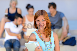 Summer college student girl smiling friends behind
