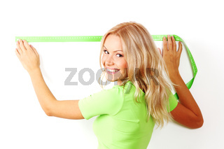 Woman measuring spacing on a wall