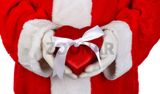 Closeup Santa Claus holding a red Valentines Heart shaped box in front of his torso.,