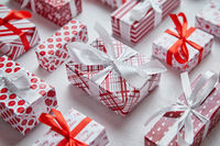 Colorful white and red Christmas theme. Wrapped gifts in festive paper with ribbon