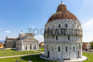 PISA, TUSCANY/ITALY  - APRIL 18 : Exterior view of the Baptistery in Pisa Tuscany Italy on April 18, 2019. Unidentified people