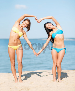 girls having fun on the beach