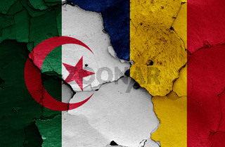 flags of Algeria and Chad painted on cracked wall