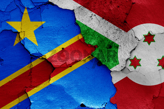 flags of DR Congo and Burundi painted on cracked wall