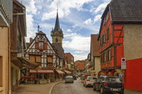 Street, houses and church towers in Obernai, Alsace, France