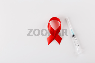 Red ribbon and syringe