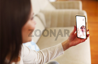 Woman having video conversation on smartphone