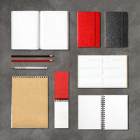 stationery books and notebooks on a concrete background