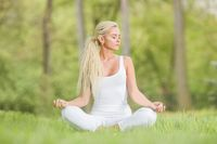 Yoga girl in lotus pose in the park