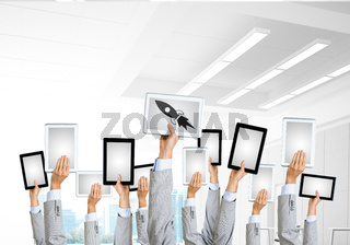Close of businessman hands in line showing tablet pc with blank screen. Mixed media