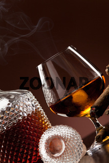 Cognac in snifter and a cigar