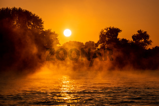 Cologne Germany rhine river sunrise with fog and mist in the morning
