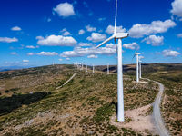 Aerial drone view of wind turbines for power generation