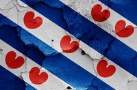 flag of Friesland painted on cracked wall